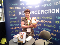 Tracey Signing Zinfandelity at the Romance Writers of American  2013 BEA booth Javits Center NYC